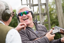 Clay Shooting man laughing