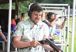 Stag party in Hawaiin shirts clay pigeon shooting