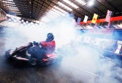 Indoor Karts going through smoke