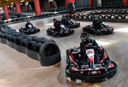 Indoor karting racing around a bend