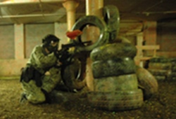 Indoor Paintball Manchester man crouching down