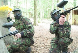 Paintball players with a smoke grenade