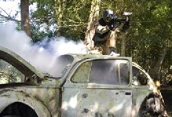 Paintball shooting from top of a smoking car