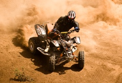 Quad biking and kicking up dirt