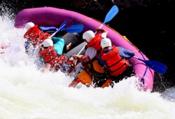 White water raft tipping